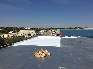 Elastomeric Roof Coating Applied to Commercial Roof